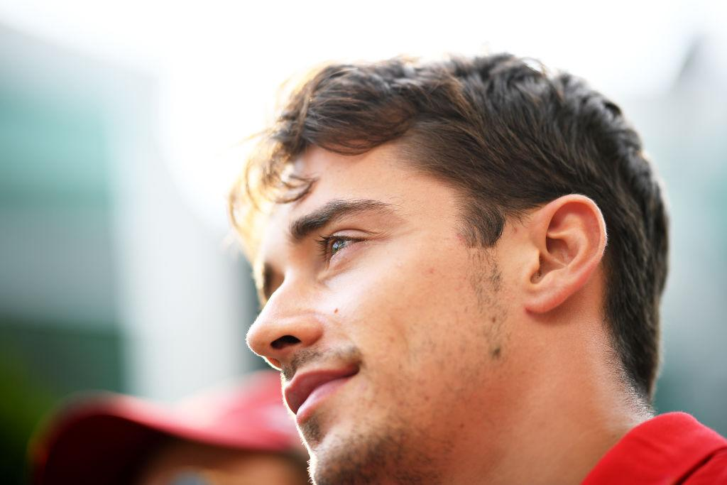 SINGAPORE - SEPTEMBER 21: Charles Leclerc of Monaco and Ferrari looks on in the Paddock before final practice for the F1 Grand Prix of Singapore at Marina Bay Street Circuit on September 21, 2019 in Singapore. (Photo by Clive Mason/Getty Images)