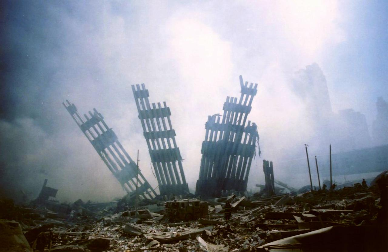 FILE - In this Sept. 11, 2001 file photo, the remains of the World Trade Center stands amid the debris following the terrorist attack on the building in New York. Osama bin Laden, the glowering mastermind behind the Sept. 11, 2001, terror attacks that killed thousands of Americans, was slain in his luxury hideout in Pakistan early Monday, May 2, 2011 in a firefight with U.S. forces, ending a manhunt that spanned a frustrating decade.
