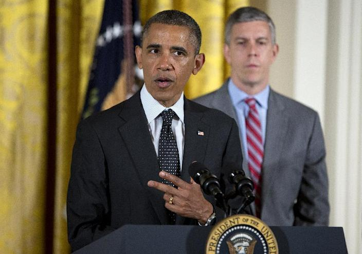 Education Secretary Arne Duncan listens as President Barack Obama speaks in the East Room of the White House in Washington, Monday, June 3, 2013, during the White House mental health conferenc. The conference was organized as part of President Obama's response to last year's shooting massacre at a Connecticut elementary school. At right is Secretary of Education Arne Duncan. (AP Photo/Evan Vucci)