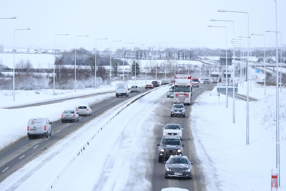 <p>Traffic is reduced to one lane in the snow on the M9 in Co. Kildare. Around 4,000 gritters are taking on the freezing weather and drivers are being urged to ask themselves if their journeys are 'really necessary'. (PA) </p>