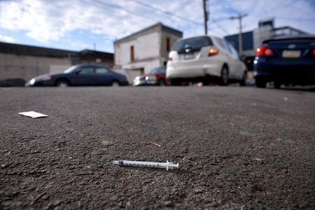 FILE PHOTO: A needle used for shooting heroin and other opioids lies in the street in the Kensington section of Philadelphia, Pennsylvania, U.S., October 26, 2017. REUTERS/Charles Mostoller/File Photo