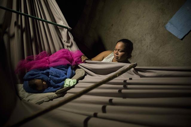 <p>A woman takes care of her son at an improvised shelter after the storm Nate, in the Iguanal community in Rivas, Nicaragua, Oct. 5, 2017. (Photo: Jorge Torres/EPA-EFE/REX/Shutterstock) </p>