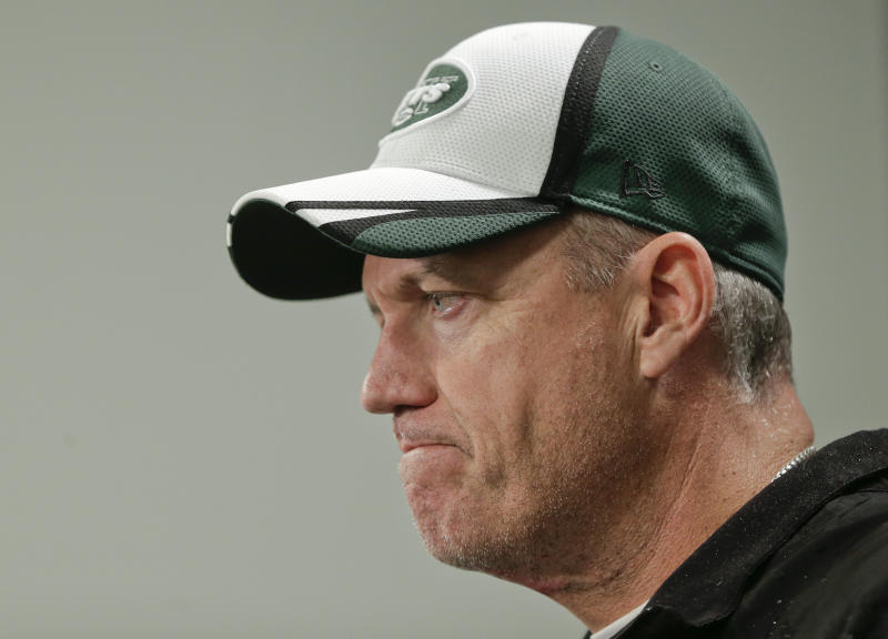 Jets' Ryan defends coach accused of hitting woman