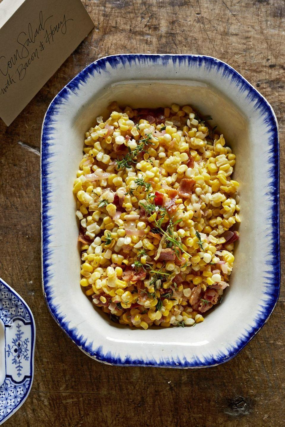 "<p>Crisp bacon meets tart sherry vinegar and sweet honey in this <a href=""https://www.countryliving.com/food-drinks/g883/southern-thanksgiving-1109/"" rel=""nofollow noopener"" target=""_blank"" data-ylk=""slk:Southern"" class=""link rapid-noclick-resp"">Southern</a>-style dish. Pro tip: Make enough for seconds!</p><p><strong><a href=""https://www.countryliving.com/food-drinks/a29134232/corn-salad-with-bacon-and-honey/"" rel=""nofollow noopener"" target=""_blank"" data-ylk=""slk:Get the recipe"" class=""link rapid-noclick-resp"">Get the recipe</a>.</strong></p><p><a class=""link rapid-noclick-resp"" href=""https://www.amazon.com/Servers-Eco-Friendly-Serving-Utensils-Display/dp/B0845V2KQH/?tag=syn-yahoo-20&ascsubtag=%5Bartid%7C10050.g.34553078%5Bsrc%7Cyahoo-us"" rel=""nofollow noopener"" target=""_blank"" data-ylk=""slk:SHOP PORTABLE SALAD BOWLS"">SHOP PORTABLE SALAD BOWLS</a></p>"