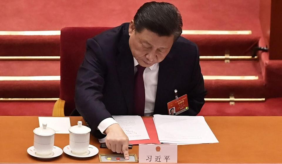China's President Xi Jinping votes on changes to Hong Kong's election system during the closing session of the National People's Congress at the Great Hall of the People in Beijing on Thursday. Photo: AFP
