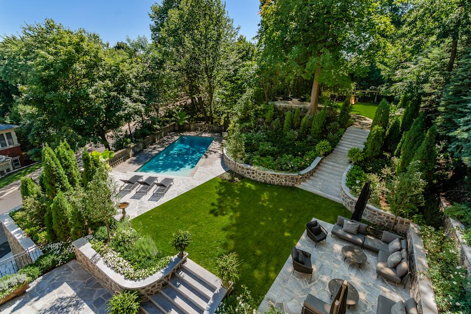 If you're not in the mood for a dip, you can keep toasty by the custom stone fire pit in the backyard big enough to host a wedding party. There's also a tree house and children's play area if you want to keep the kiddos out of your hair.
