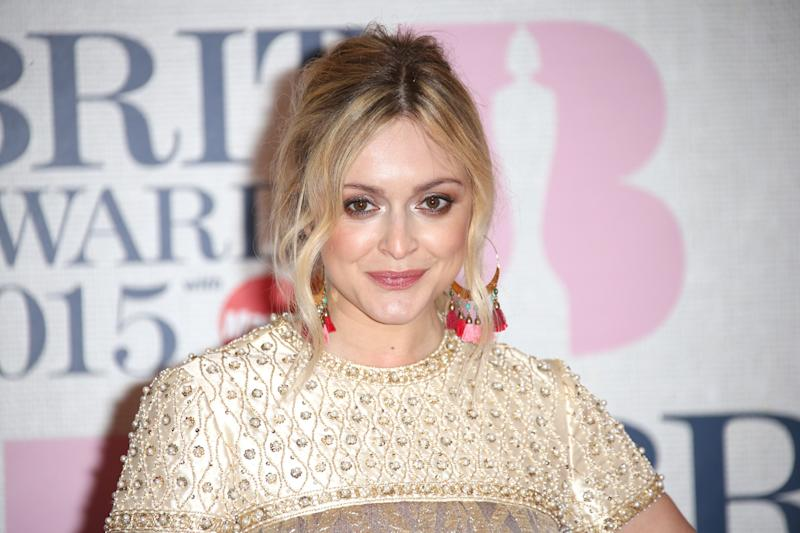 Fearne Cotton poses for photographers upon arrival at the Brit Awards 2015 at the 02 Arena in London, Wednesday, Feb. 25, 2015. (Photo by Joel Ryan/Invision/AP)