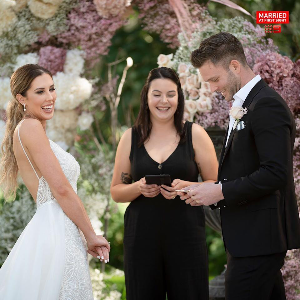Married At First Sight 2021 contestants Bec Zemek and Jake Edwards standing at the altar with a celebrant at their wedding