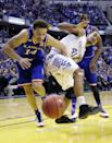 Kansas's Brannen Greene, left, battles with Kentucky's Trey Lyles in the first half of an NCAA college basketball game in Indianapolis, Tuesday, Nov. 18, 2014. (AP Photo/Michael Conroy)