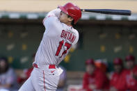 Los Angeles Angels' Shohei Ohtani hits a double against the Oakland Athletics during the third inning of a baseball game in Oakland, Calif., Monday, July 19, 2021. (AP Photo/Jeff Chiu)