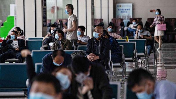 PHOTO: Passengers wait at a long-distance bus station in Wuhan in China's central Hubei province, on April 30, 2020, ahead of the Labor Day holiday which starts on May 1. (Str/AFP via Getty Images)