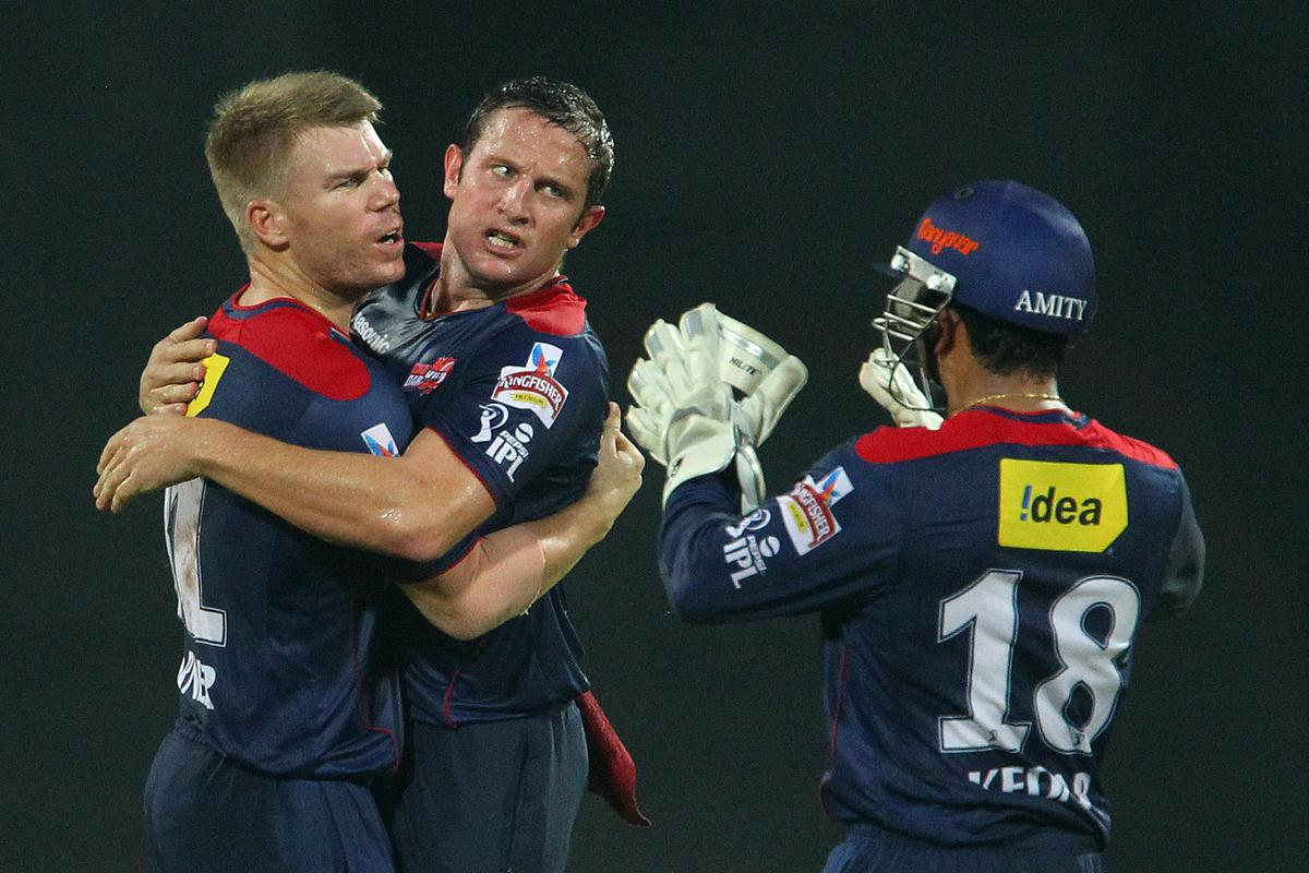 David Warner celebrates the wicket of Suresh Raina with Roelof van der Merwe during match 64 of the Pepsi Indian Premier League between The Chennai Superkings and the Delhi Daredevils held at the MA Chidambaram Stadium in Chennai on the 14th May 2013..Photo by Ron Gaunt-IPL-SPORTZPICS   .. .Use of this image is subject to the terms and conditions as outlined by the BCCI. These terms can be found by following this link:..https://ec.yimg.com/ec?url=http%3a%2f%2fwww.sportzpics.co.za%2fimage%2fI0000SoRagM2cIEc&t=1490464673&sig=1iHCYzPVPqaQuFJ1OSVSMQ--~C