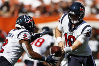 Houston Texans quarterback Davis Mills (10) hands the ball off to running back Mark Ingram (2) during the second half of an NFL football game against the Cleveland Browns, Sunday, Sept. 19, 2021, in Cleveland. (AP Photo/Ron Schwane)