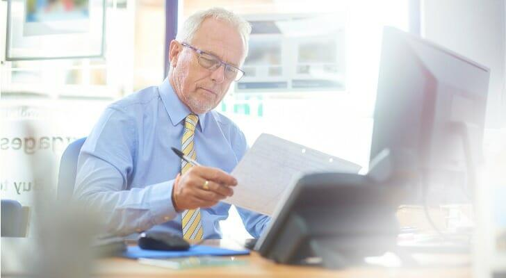 An accountant uses tax software to prepare tax documents for a small business client.