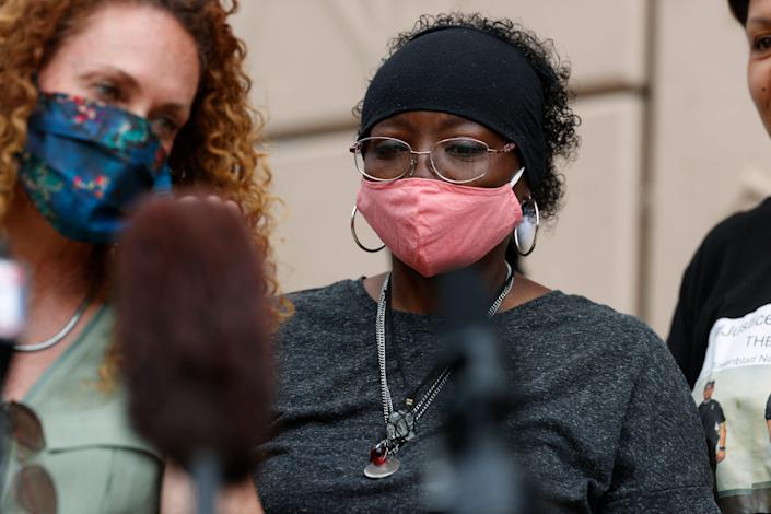 Sheneen McClain, right, and family attorney Mari Newman speak during a news conference at the memorial site across the street from where McClain's 23-year-old son, Elijah, was stopped by police officers, in Aurora, Colorado.