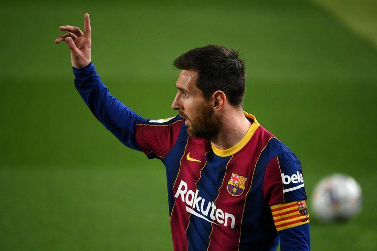(FILES) In this file photo taken on February 24, 2021 Barcelona's Argentinian forward Lionel Messi gestures during the Spanish league football match between FC Barcelona and Elche CF at the Camp Nou stadium in Barcelona. - Lionel Messi will end his 20-year career with Barcelona after the Argentine superstar failed to reach agreement on a new deal with the club, the Spanish giants announced on August 5, 2021. (Photo by LLUIS GENE / AFP)