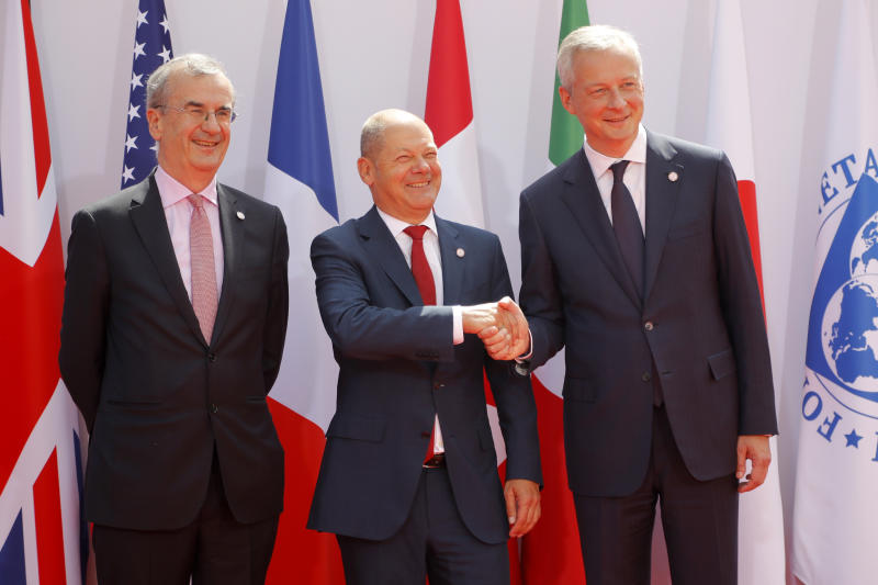 French Finance Minister Bruno Le Maire, right, welcomes German Finance Minister Olaf Scholz, center, with Governor of the Bank of France Francois Villeroy de Galhau, at the G-7 Finance Wednesday July 17, 2019.The top finance officials of the Group of Seven rich democracies are arriving at Chantilly, at the start of a two-day meeting aimed at finding common ground on how to tax technology companies and on the risk from new digital currencies. (AP Photo/Michel Euler)
