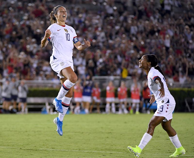 PASADENA, CALIFORNIA - AUGUST 03: Carli Lloyd #10 of the United States celebrates her goal with Crystal Dunn #19, to take a 3-0 lead over the Republic of Ireland, during the first half of the first game of the USWNT Victory Tour at Rose Bowl on August 03, 2019 in Pasadena, California. (Photo by Harry How/Getty Images)