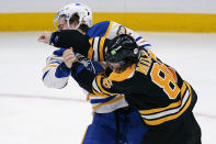 Boston Bruins defenseman Kevan Miller (86) follows through after landing a punch while fighting Buffalo Sabres right wing Tage Thompson during the second period of an NHL hockey game Tuesday, April 13, 2021, in Boston. (AP Photo/Charles Krupa)