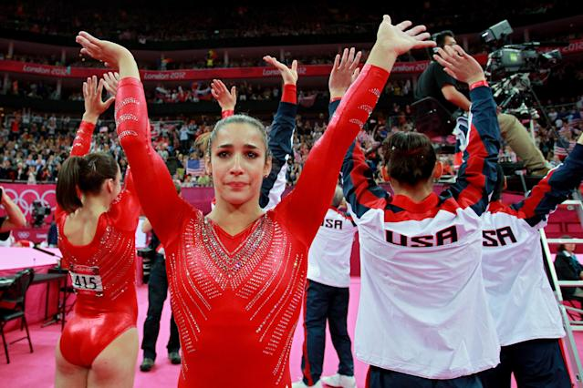 Alexandra Raisman of the United States celebrates during the final rotation in the Artistic Gymnastics Women's Team final on Day 4 of the London 2012 Olympic Games at North Greenwich Arena on July 31, 2012 in London, England. (Photo by Ronald Martinez/Getty Images)