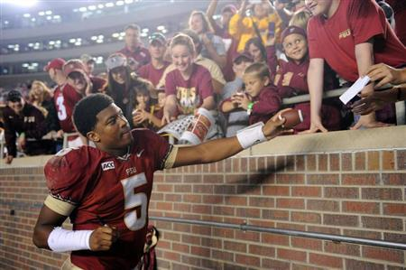Florida State Seminoles quarterback Jameis Winston (5) signs autographs for fans after the game against the Idaho Vandals at Doak Campbell Stadium. Mandatory Credit: Melina Vastola-USA TODAY Sports