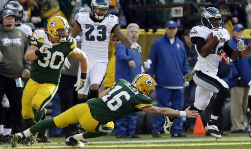 Philadelphia Eagles' Brandon Boykin (22) gets past Green Bay Packers quarterback Scott Tolzien after intercepting a pass during the first half of an NFL football game Sunday, Nov. 10, 2013, in Green Bay, Wis. (AP Photo/Mike Roemer)
