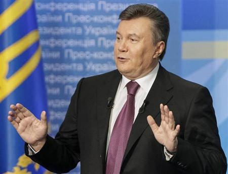 Ukrainian President Yanukovich gestures during a news conference in Kiev