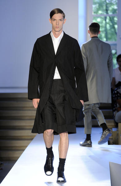 A model wears a creation of the Jil Sander men's Spring-Summer 2014 collection, part of the Milan Fashion Week, unveiled in Milan, Italy, Saturday, June 22, 2013. (AP Photo/Giuseppe Aresu)