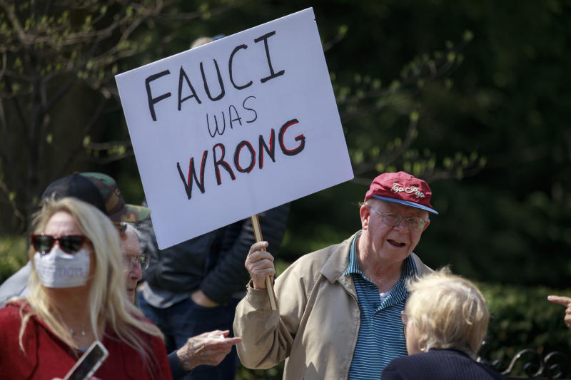 A man holds a placard that says Fauci was wrong during the demonstration in Indianapolis, Indiana on April 18, 2020. (Jeremy Hogan/SOPA Images/LightRocket via Getty Images)
