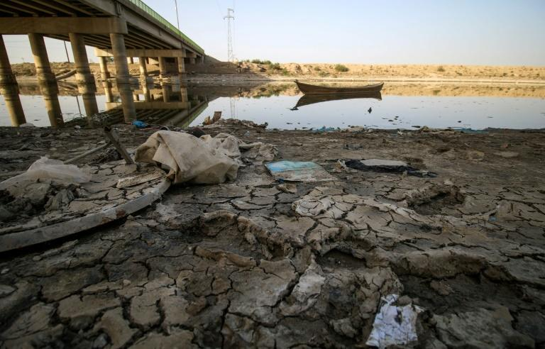 A picture taken on March 20, 2018 shows a view of the dried-up shore of an irrigation canal near the village of Sayyed Dakhil, south of Baghdad