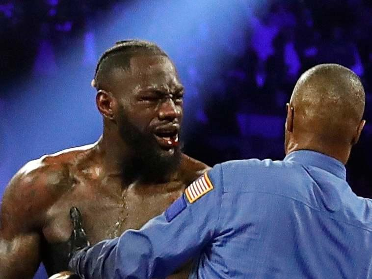 Deontay Wilder remonstrates with referee Kenny Bayliss: REUTERS