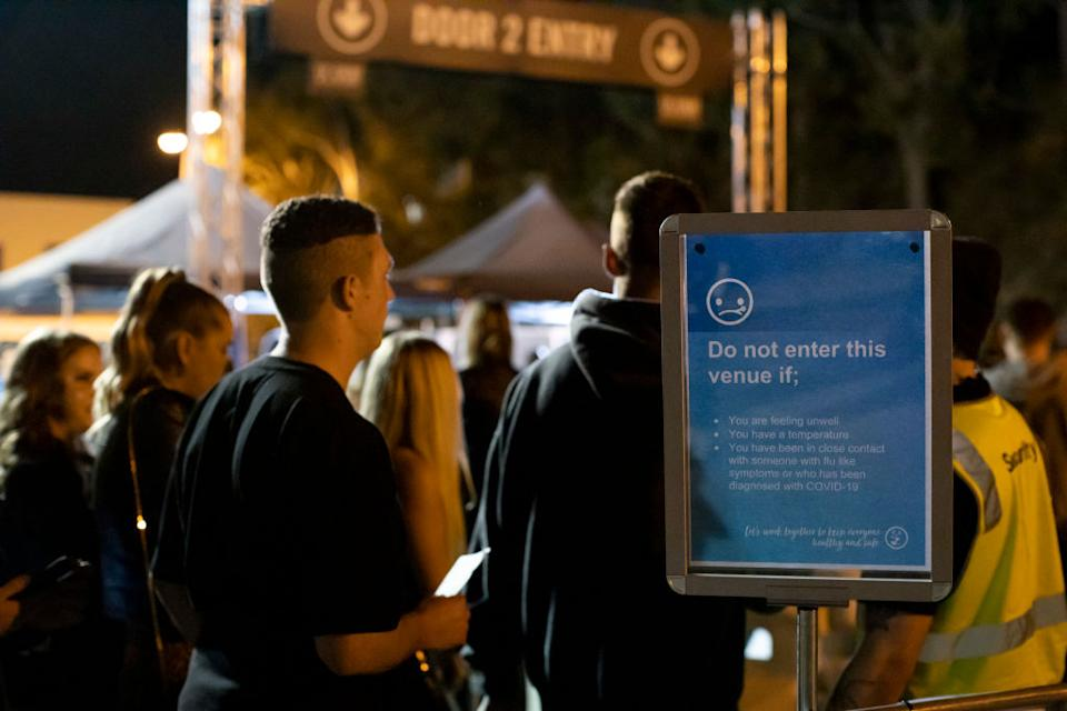 Patrons line up to enter a festival at HBF Stadium on July 18 in Perth. Source: Getty