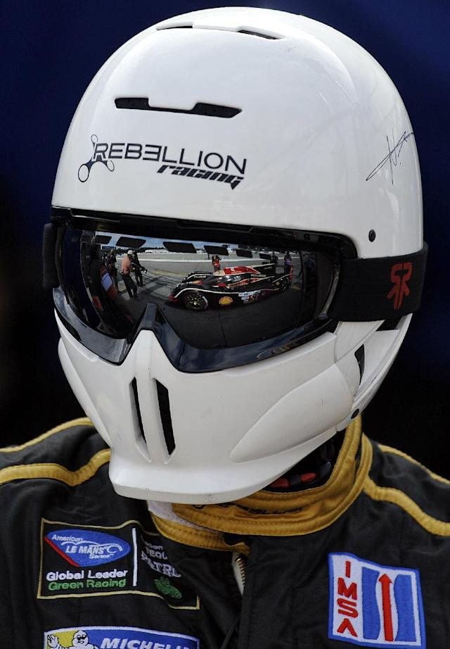 The Rebellion Racing Lola B12/60 car is reflected in the goggles of a crew member during qualifying for the American Le Mans Series' Petit Le Mans auto race at Road Atlanta, Friday, Oct. 18, 2013, in Braselton, Ga. (AP Photo/Rainier Ehrhardt)