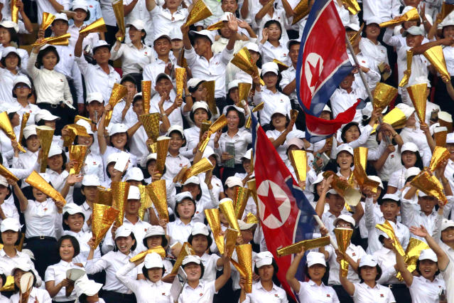 North Korea's fans celebrate during the World Cup Group H qualifying soccer match between North Korea and Lebanon at the Kim Il Sung Stadium in Pyongyang, Thursday, Sept. 5, 2019. North Korea won the game 2-0. (AP Photo/Jon Chol Jin)