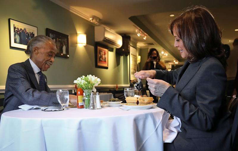 Harris and Rev. Al Sharpton have lunch at Sylvia's in New York on Feb. 21.