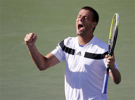 Youzhny of Russia celebrates his victory over Hewitt of Australia at the U.S. Open tennis championships in New York