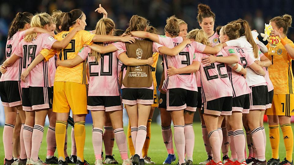 Players of Scotland huddle after their loss. (Photo by Daniela Porcelli/Getty Images)