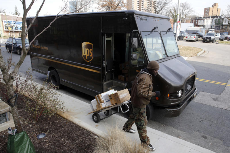 UPS falls short of forecasts on bad weather, costs