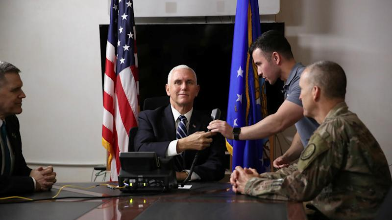 Mike Pence makes surprise visit to Iraq as deadly violence continues