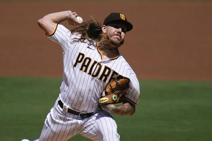 San Diego Padres starting pitcher Mike Clevinger works against a Los Angeles Angels batter.
