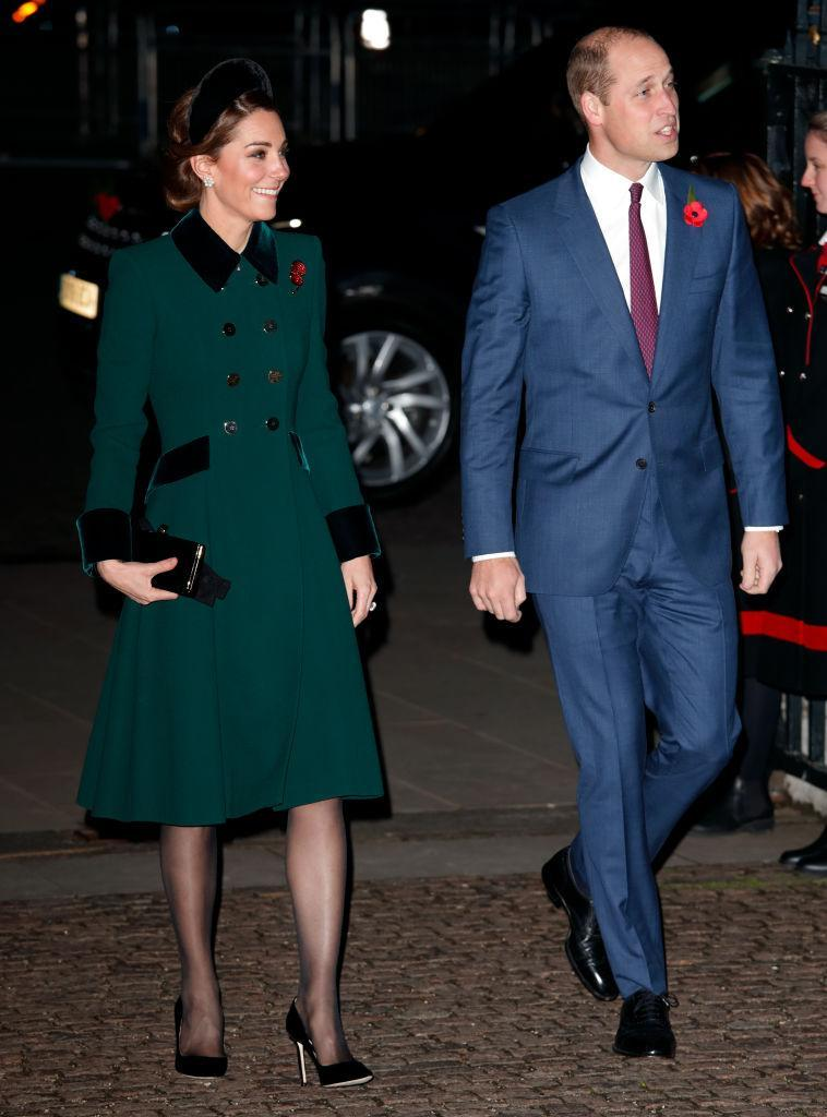 <p>For an evening Remembrance Service at Westminster Abbey, the Duchess recycled a Catherine Walker coat. This time, she accessorised the look with a velvet headband. <em>[Photo: Getty]</em> </p>
