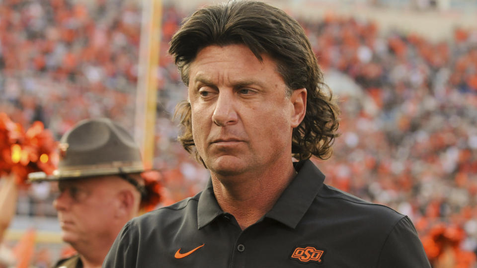 Oklahoma State head coach Mike Gundy takes the field prior to an NCAA college football game in Stillwater, Okla., Saturday, Sept. 28, 2019. (AP Photo/Brody Schmidt)