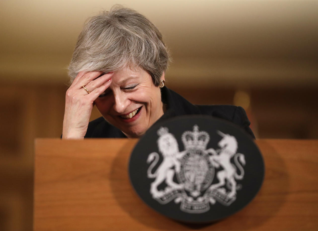 Britain's Prime Minister Theresa May reacts during a press conference inside 10 Downing Street in London, Thursday, Nov. 15, 2018. Two British Cabinet ministers, including Brexit Secretary Dominic Raab, resigned Thursday in opposition to the divorce deal struck by Prime Minister Theresa May with the EU — a major blow to her authority and her ability to get the deal through Parliament. (AP Photo/Matt Dunham, Pool)