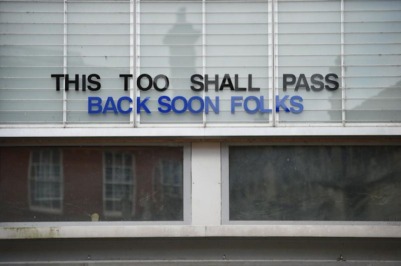 A sign is seen on the front of a closed cinema in York, northern England, on March 30, 2020, as life in Britain continues during the nationwide lockdown to combat the novel coronavirus pandemic. - Life in locked-down Britain may not return to normal for six months or longer as it battles the coronavirus outbreak, a top health official warned on Sunday, as the death toll reached passed 1,200. (Photo by Oli SCARFF / AFP) (Photo by OLI SCARFF/AFP via Getty Images)
