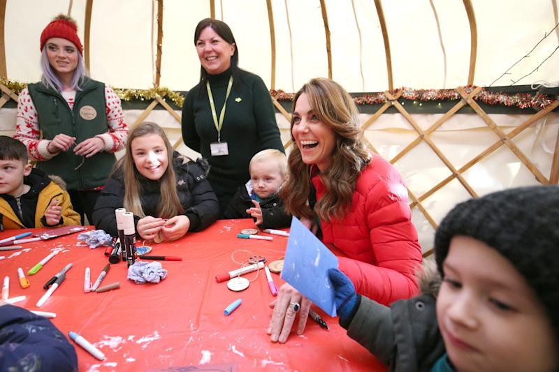 GREAT MISSENDEN, ENGLAND - DECEMBER 04: Catherine, Duchess of Cambridge takes part in Christmas activities with families and children who are supported by the Family Action charity during a visit to Peterley Manor Farm in Buckinghamshire on December 4, 2019 in Great Missenden, England. (Photo by Jonathan Brady - WPA Pool/Getty Images)