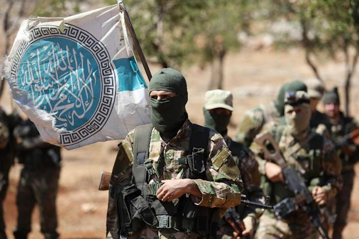 Syrian rebels attend a mock battle in anticipation of an attack by the regime on Idlib province during a graduation of new Hayat Tahrir al-Sham (HTS) members in northern Idlib province, on August 14, 2018 (AFP Photo/OMAR HAJ KADOUR)