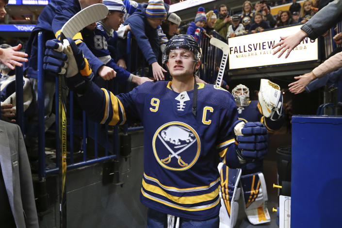 Buffalo Sabres forward Jack Eichel (9) is greeted by fans prior to the first period of an NHL hockey game against the Tampa Bay Lightning, Tuesday, Dec. 31, 2019, in Buffalo, N.Y. The Sabres front office and roster have undergone numerous changes in the seven months since captain Jack Eichel said he was fed up with losing after Buffalo missed the playoffs for a ninth consecutive year. (AP Photo/Jeffrey T. Barnes)