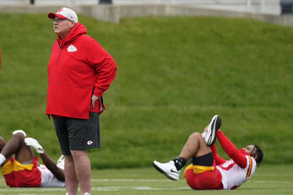 Kansas City Chiefs head coach Andy Reid watches an NFL football rookie minicamp Saturday, May 15, 2021, in Kansas City, Mo. (AP Photo/Charlie Riedel)