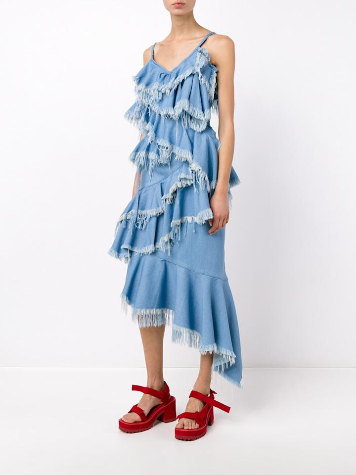 """<p>Marques Almeida always gets our attention with an array of unique asymmetrical designs. This ruffled top and matching skirt would make for an incredible evening look. <a href=""""http://www.brownsfashion.com/product/017H25850003/109/frayed-denim-frill-top?gclid=CP7HwJusrssCFbQV0wodSTwPeQ""""><i>[Marques Almeida, £195]</i></a></p>"""