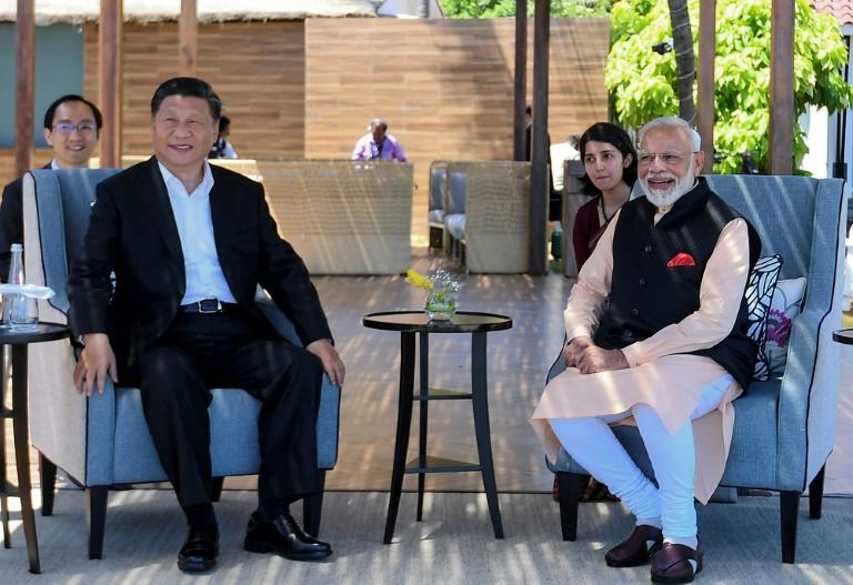 """India's Prime Minister Narendra Modi (R) told Chinese President Xi Jinping (L) that their summit would launch a """"new era of cooperation"""" between the world's two largest nations (AFP Photo/Handout)"""